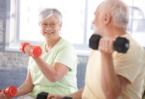 elderly people lifting weights