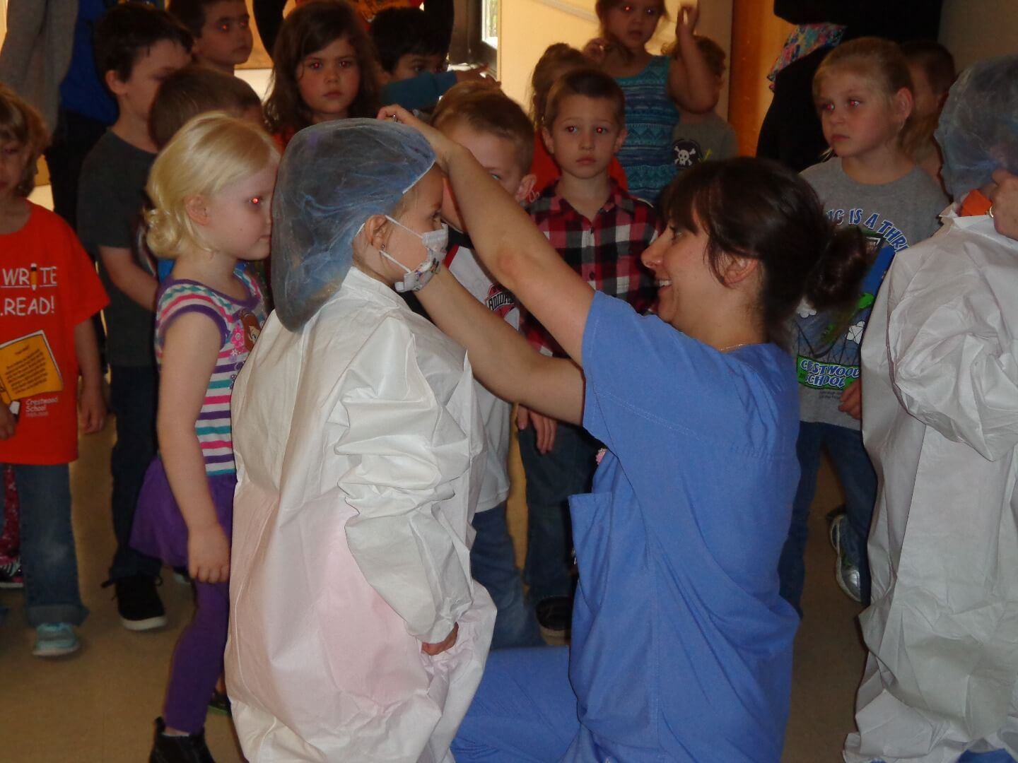 nurse dressing up a kid